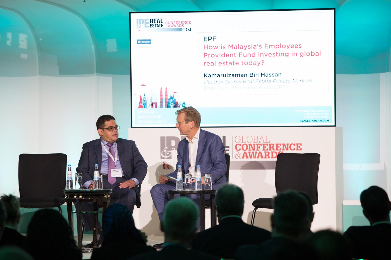 Piet Eichholtz (right) interviews Kamarulzaman Bin Hassan, Employees Provident Fund